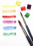Watercolouranschläge über Weiß Stockfotos