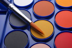 Watercolours and brush closeup Royalty Free Stock Image