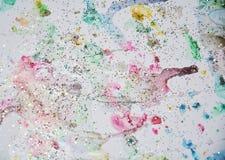 Watercor油漆金黄蓝色桃红色形状、形式和闪耀的光,抽象背景 免版税库存图片