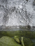 Watercourse brown reflexion stones. Water with reflexion and stones Stock Images