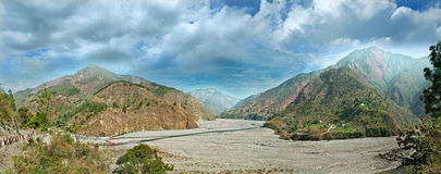 Watercourse river with mountain ranges. India, Uttarakhand Stock Images