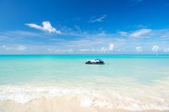Watercraft on clear sea water in st johns, antigua. Watercraft on clear sea or ocean water in st johns, antigua, with white sand on sunny day on blue sky Royalty Free Stock Photo