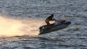 Watercraft elevates after hitting a wave Stock Photo