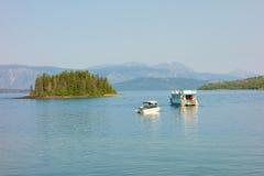 Watercraft enjoying lake atlin on a sunny day Stock Photography