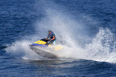 Watercraft Fun!. An enthusiast rides the waves in a personal watercraft Royalty Free Stock Image