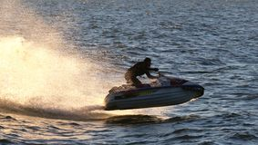 Watercraft jet skims across the waves. Race-Ready and Performance Wave Runners Demo/Competition event 2015, Lake Erie, United States Royalty Free Stock Image