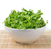 Watercress in bowl on bamboo Stock Photography