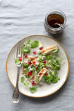 Watercress salad with grilled chicken breast,feta cheese and pomegranate seeds Royalty Free Stock Images