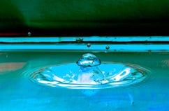 Waterdaling en spalsh Stock Foto's