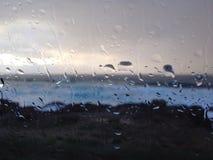 Waterdalingen in een venster Royalty-vrije Stock Foto