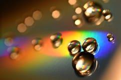 Waterdalingen op CD en DVD Abstract behang Royalty-vrije Stock Afbeeldingen
