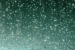 Waterdrop on glass Stock Photos