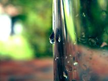 Waterdrop on glass in nature stock photography