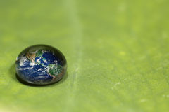 Waterdrop on a leaf reflecting earth concept Royalty Free Stock Photography