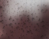 Waterdrop and Raindrop. On pink background Royalty Free Stock Photo