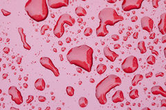 Waterdrop on red painting surface Stock Images