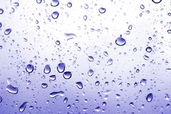 Waterdrops #2. Waterdrops on a window - Blue color royalty free stock images
