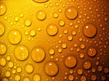 Waterdrops auf Orange Lizenzfreie Stockfotos