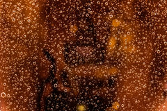 Waterdrops Background. Water drops reflecting light on the window glass Royalty Free Stock Photography