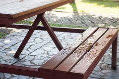 Waterdrops on bench in summer Royalty Free Stock Photo