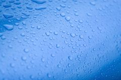 Waterdrops blue. Waterdrops on a blue metal background Stock Photos