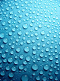 Waterdrops on blue. Waterdrops on bright blue background stock images