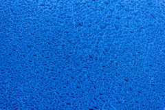 Waterdrops on blue car paint as underground. Selective focus stock images