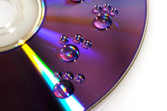 Waterdrops footprint on cd Stock Photography