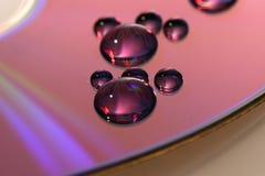 Waterdrops footprint on cd Stock Image