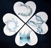 Waterdrops i hjärtorna som gör sammandrag pappers- collage royaltyfri foto