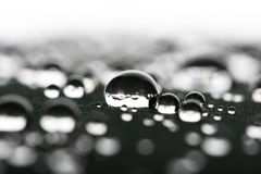 Waterdrops macro close up. Waterdrops on gray surface macro close up Stock Images