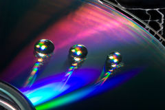 Waterdrops op een CD Stock Foto's