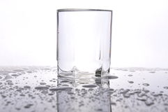 Waterdrops on the table. Pure glass and waterdrops on the table stock photo