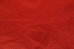 Waterdrops texture on orange red background. Nice texture of water drops on a red nylon canvas Stock Photo