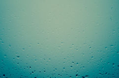 Waterdrops. Window glass covered by waterdrops stock photo