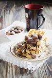 Watered chocolate waffles Stock Photos