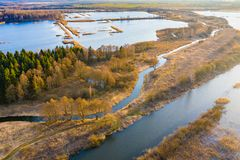 Watered peat bogs in countryside. Sunny landscape. Aerial scenery. Rural landscape stock photos