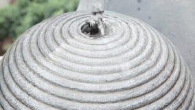 Waterelement. Spilling water in a garden stock footage