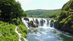 Waterfall - Štrbački buk. Štrbački buk is a 24 m high waterfall on the river Uni near the village of Kulen Vakuf and Orašac, which is located near the Stock Image