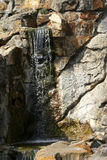 Waterfall. A small waterfall over the rocks Stock Photo