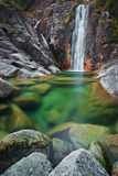 Waterfall. The Arado river in Peneda-Gerês National Park (northern Portugal) flows into a green pool Stock Photos