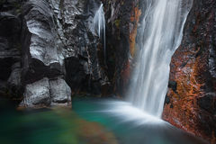 Waterfall. The Arado river in Peneda-Gerês National Park (northern Portugal) flows into a green pool Stock Image