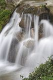 Waterfall. Peaceful waterfall in a tea garden Royalty Free Stock Photos