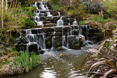 The waterfall. The small waterfall in the park Royalty Free Stock Photo