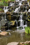 The waterfall. The small waterfall in the park Stock Photos
