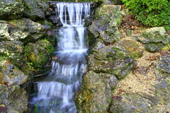 Waterfall. A small garden waterfall in a garden royalty free stock photo