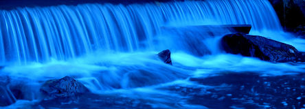 Waterfall. Blue water in panoramic photo stock image