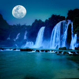 Waterfall. Beautiful waterfall under moonlight at night time