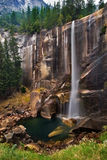 Waterfall. Autumn waterfall in high rocks royalty free stock images