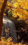Waterfall. In surrounded by Autumn colors royalty free stock photography